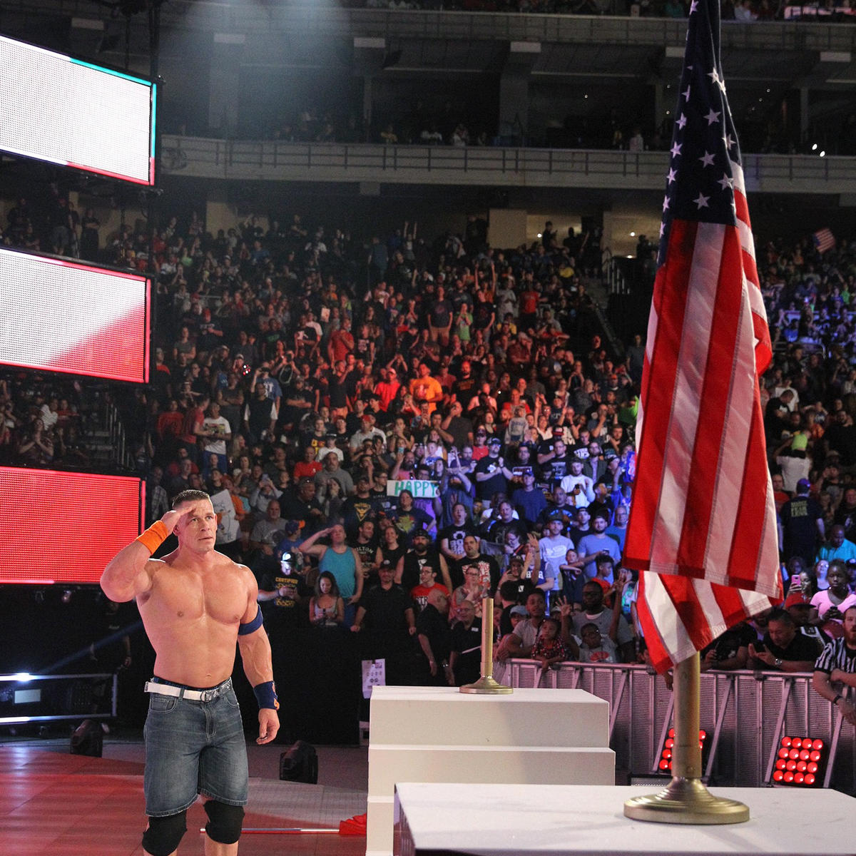 Cena salutes the stars and stripes before making his triumphant exit.