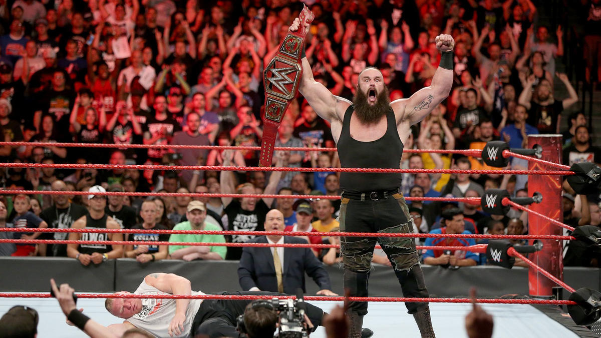 The Monster Among Men celebrates with the Universal Championship.