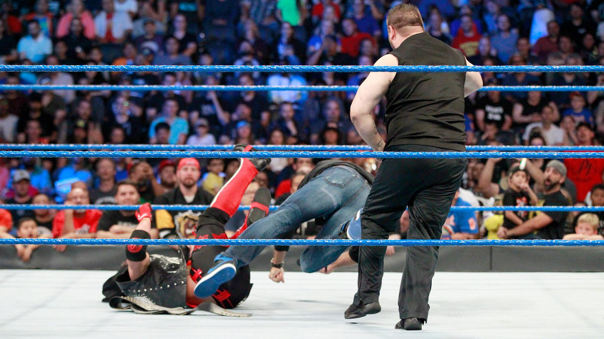Styles attempts to hit Owens with a Pele kick but instead drills Shane in the face!