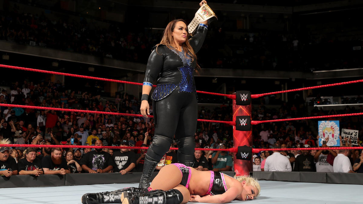 Nia holds up the Raw Women's Championship as Raw concludes.