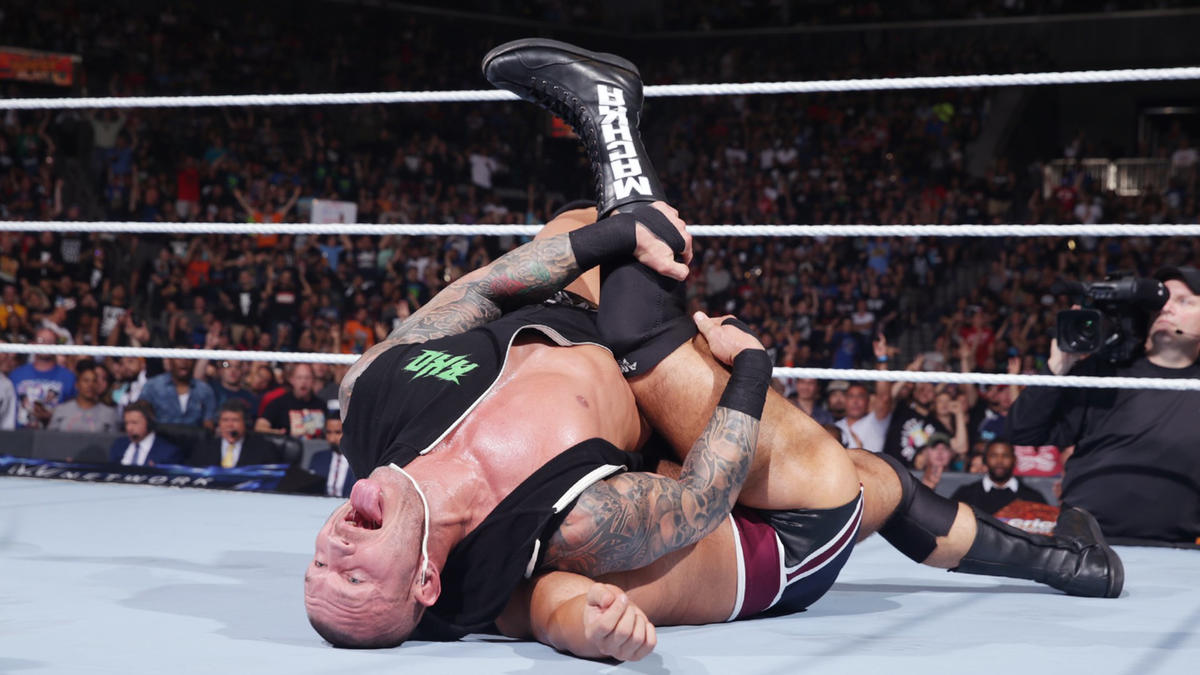 Orton hits a devastating RKO out of nowhere and wins the match in less than 10 seconds!