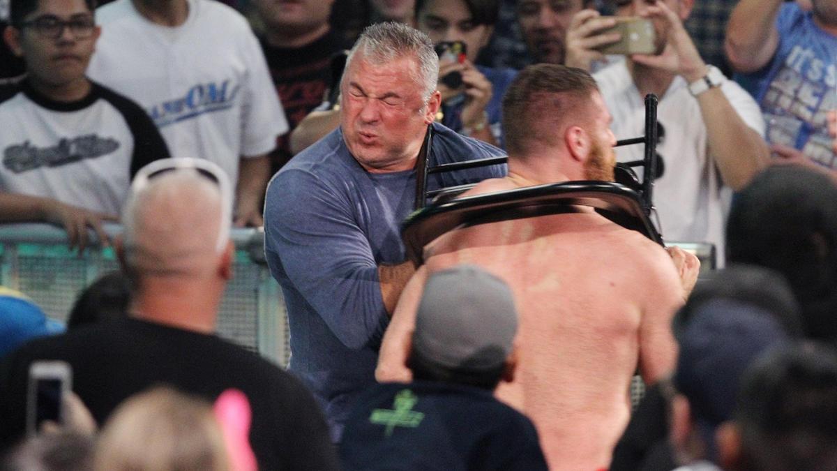 Owens shoves Zayn into Shane...