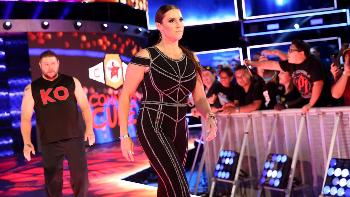 A furious Stephanie McMahon stares daggers through KO and goes to check on her father.