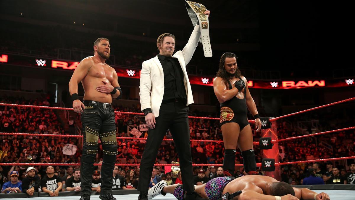 ... and stands tall with his cohorts as Raw concludes.