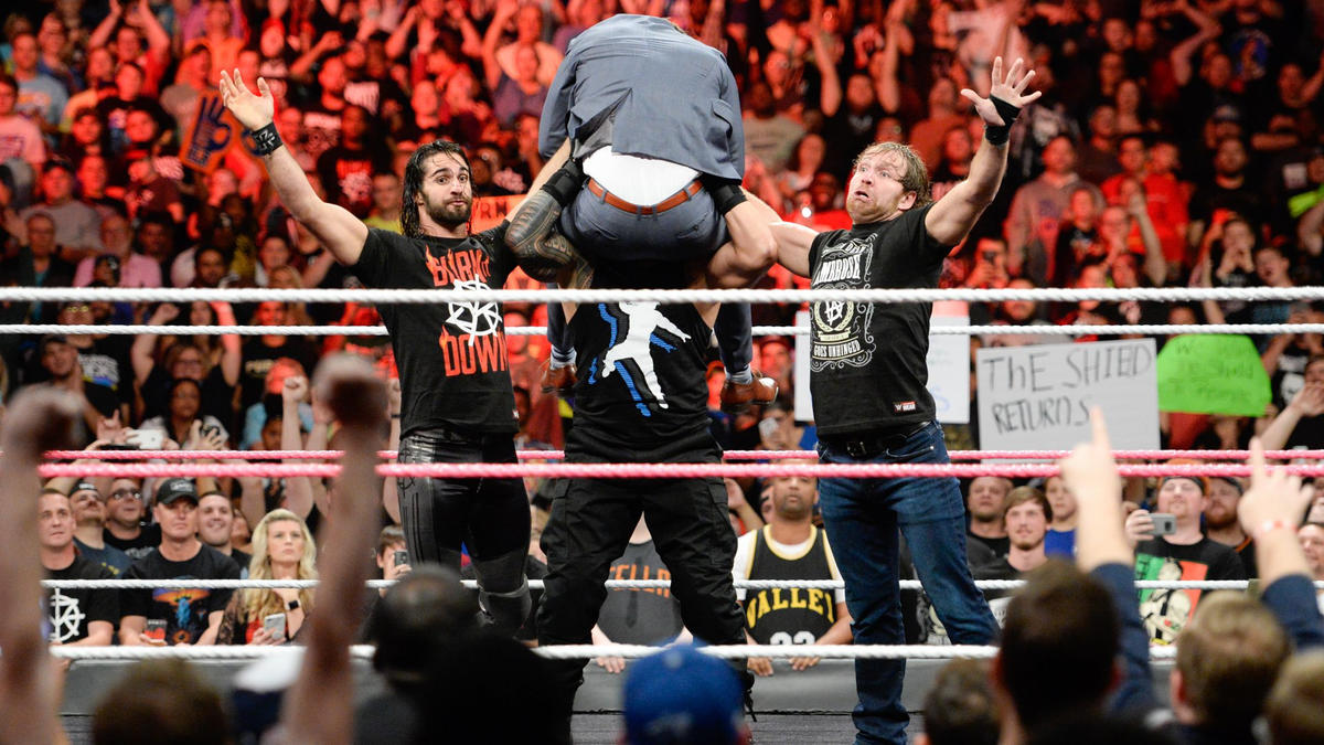 The Hounds of Justice hoist Miz into the air and...