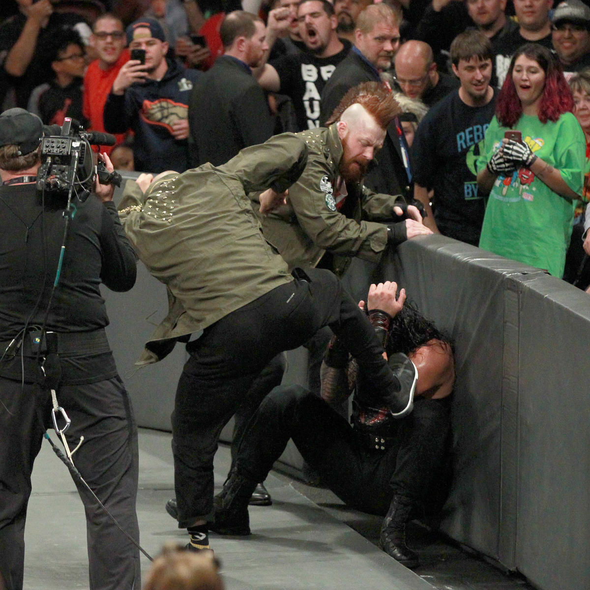 Just as Reigns is prepared to hit the Spear on Miz, Sheamus & Cesaro attack!