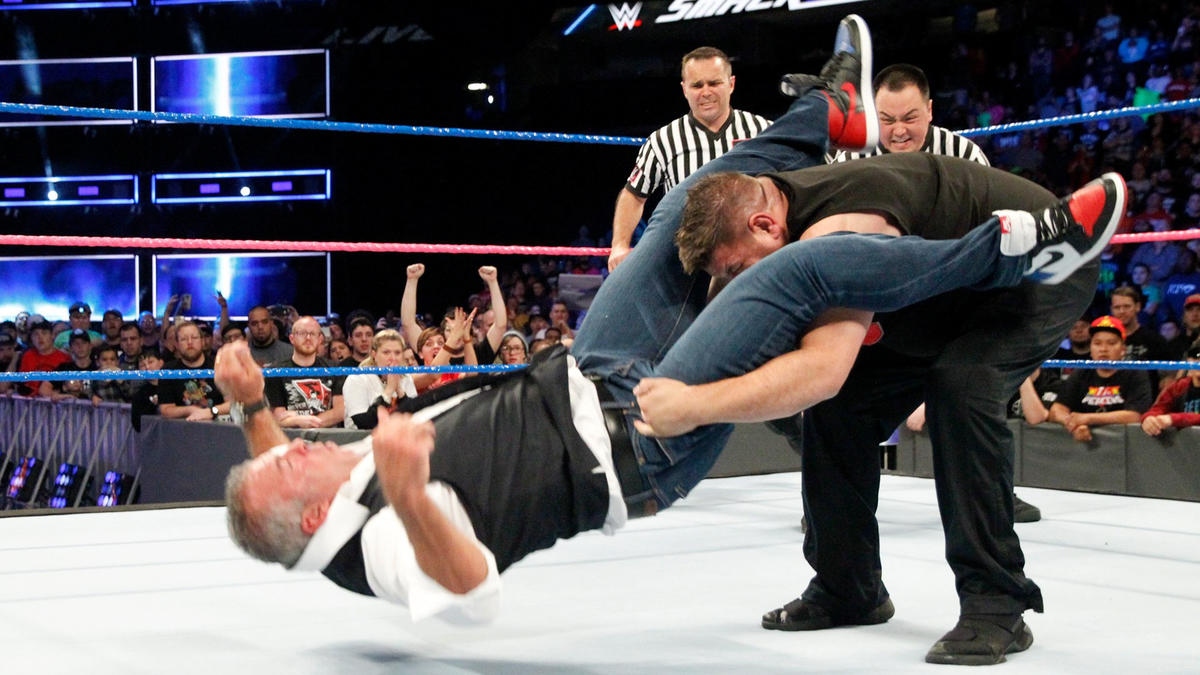 ... and drives Shane into the canvas with a Pop-up Powerbomb!