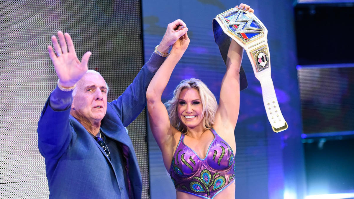 Charlotte and Ric Flair share an emotional moment following The Queen's dramatic title victory.