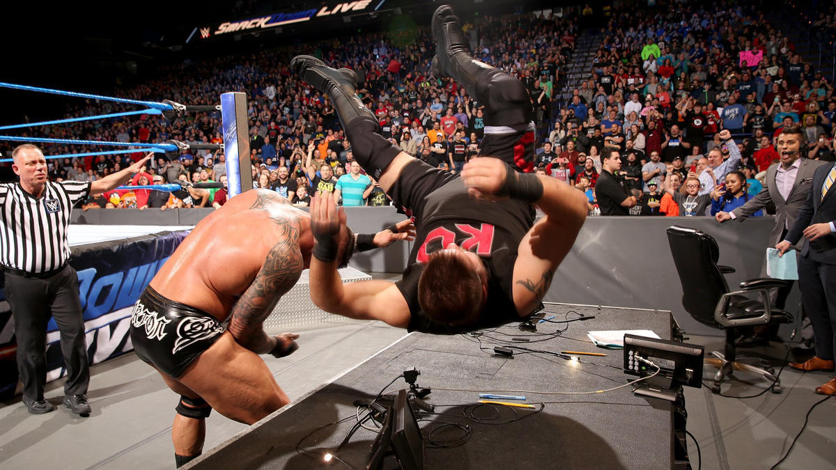 Orton drops KO onto the announce table!
