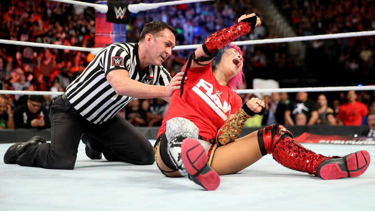 Asuka takes out both Tamina and Natalya to claim victory for Team Raw.