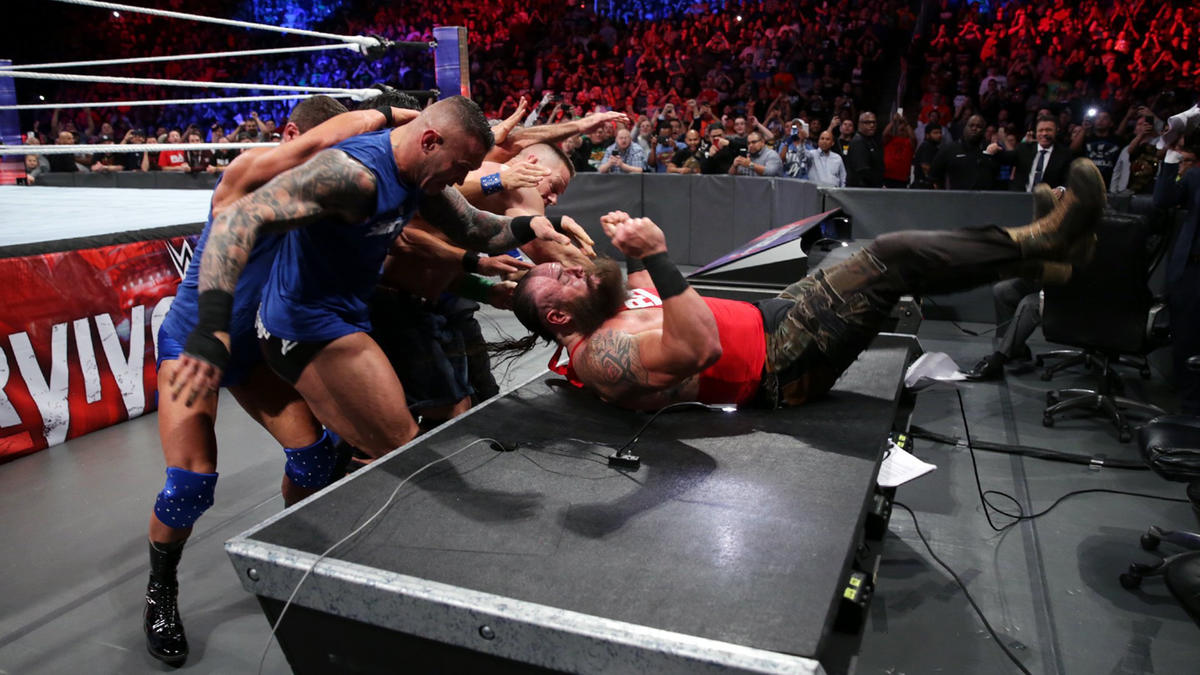 Team SmackDown joins forces to slam The Monster Among Men through a table.