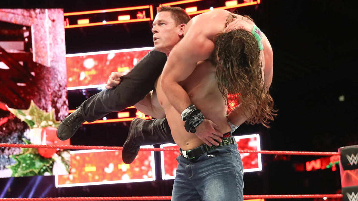 Cena drops Elias with the Attitude Adjustment to get the 1-2-3 on Christmas!