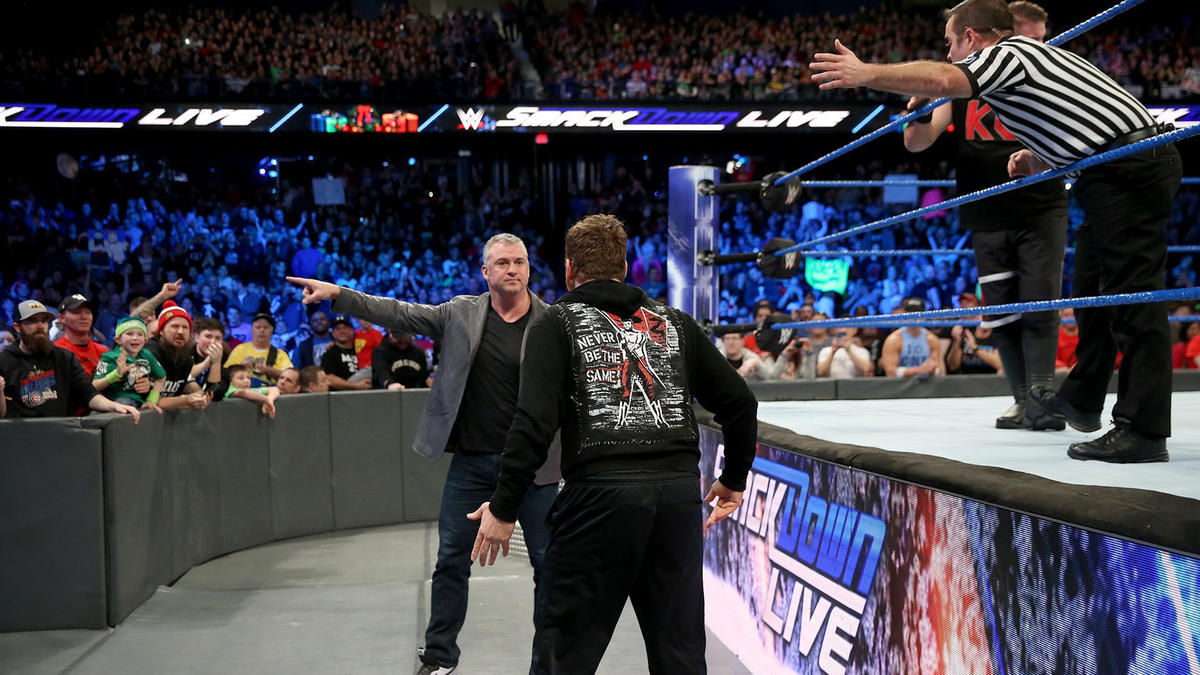 Shane McMahon hits the scene, and he and the official eject Zayn from ringside!