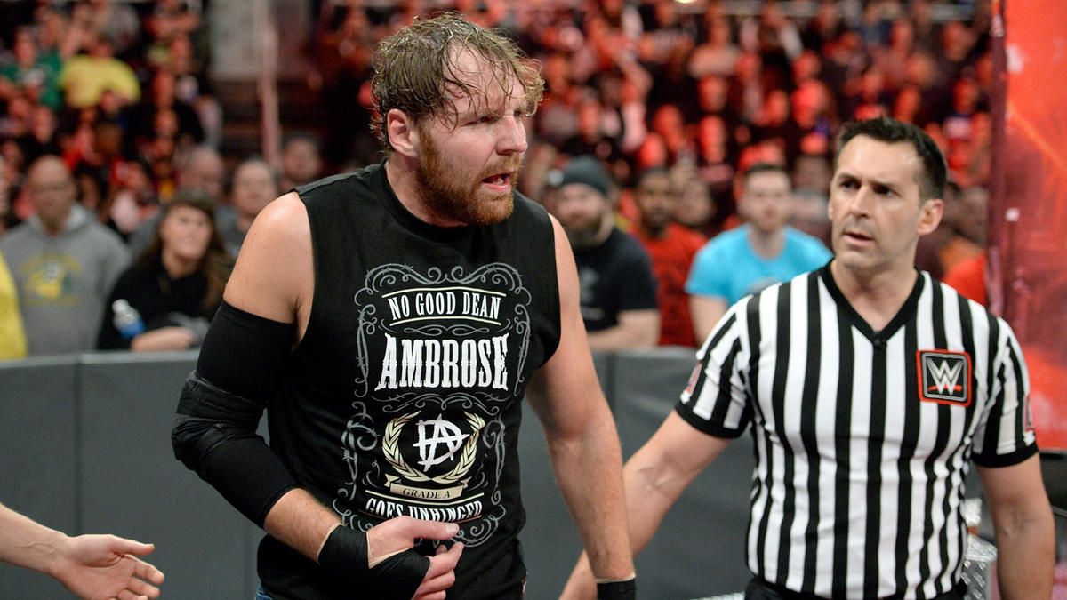 Dean Ambrose grimaces after suffering an apparent arm injury.