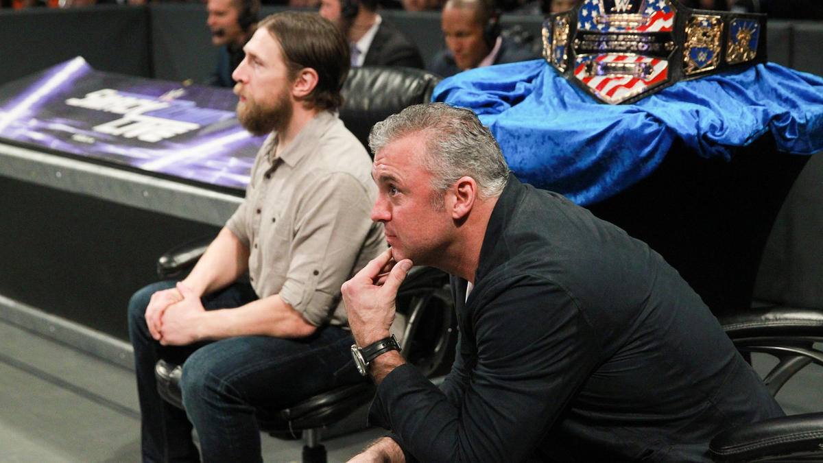 Shane McMahon and Daniel Bryan keep a close eye on the all-important title bout.
