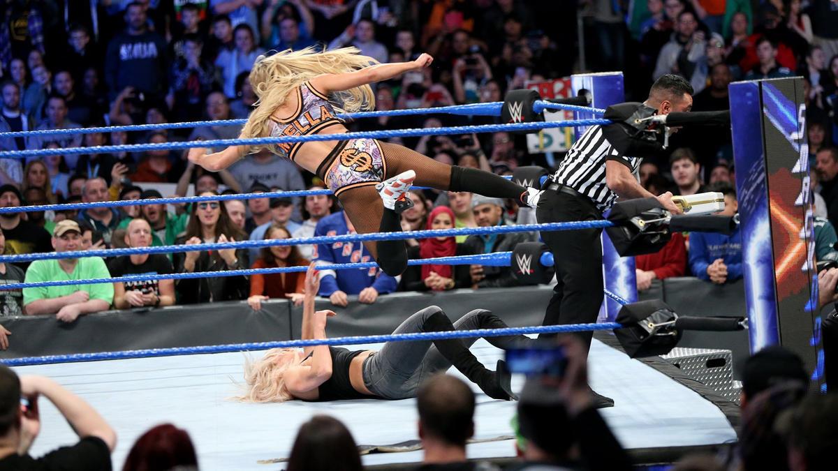 Charlotte avoids Carmella's dropkick...