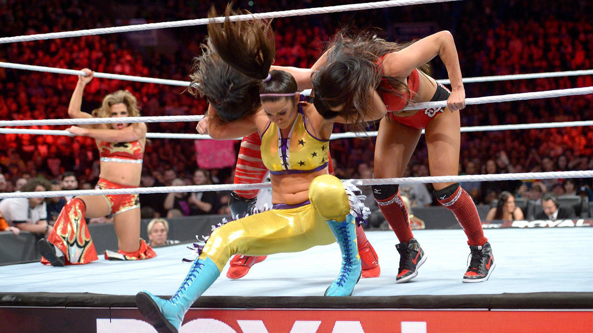 Bayley enters the fray and takes out The Bellas.