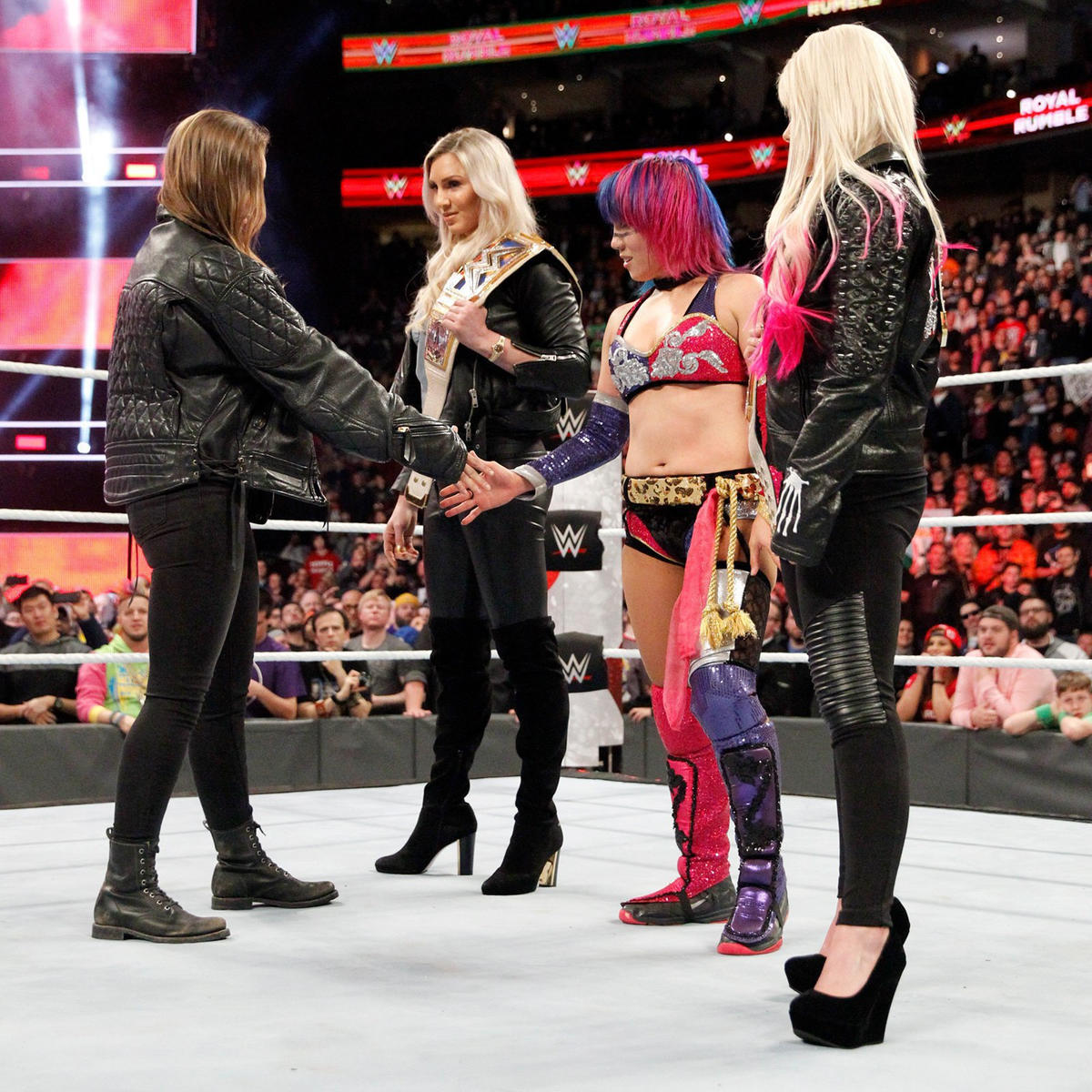Asuka is not impressed by Rousey and refuses to shake her hand.