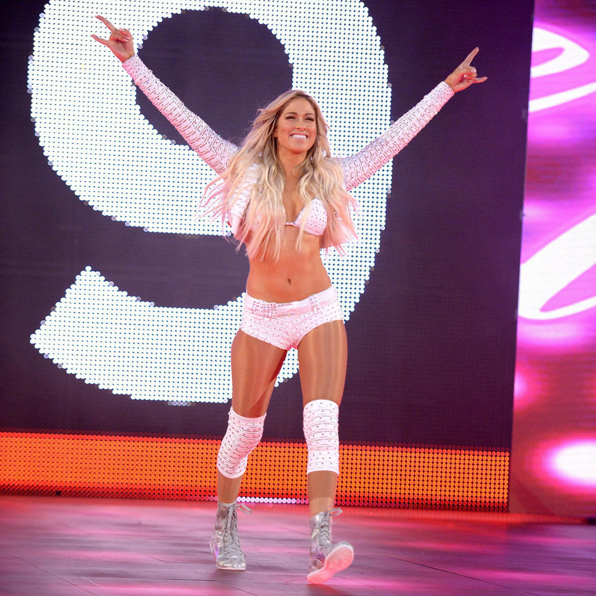 The WWE Universe erupts with glee as Kelly Kelly makes a surprise return.