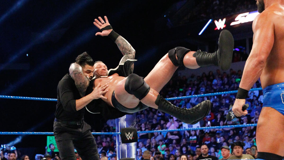 Suddenly, Orton strikes with an RKO on Sunil Singh...