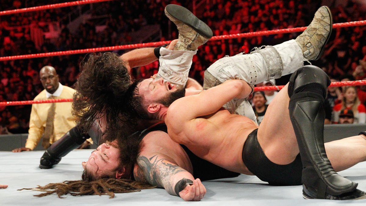Rollins and Bálor each pin Wyatt for the 1-2-3!
