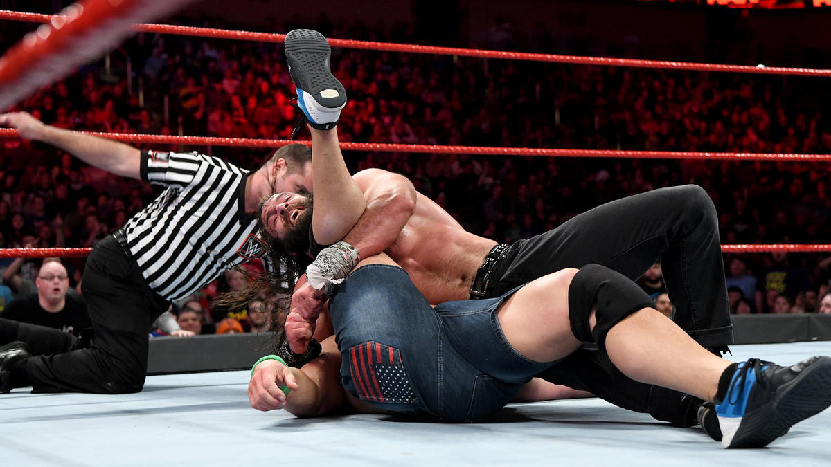 ... but Elias shoves Strowman out of the ring and pins Cena for the win!