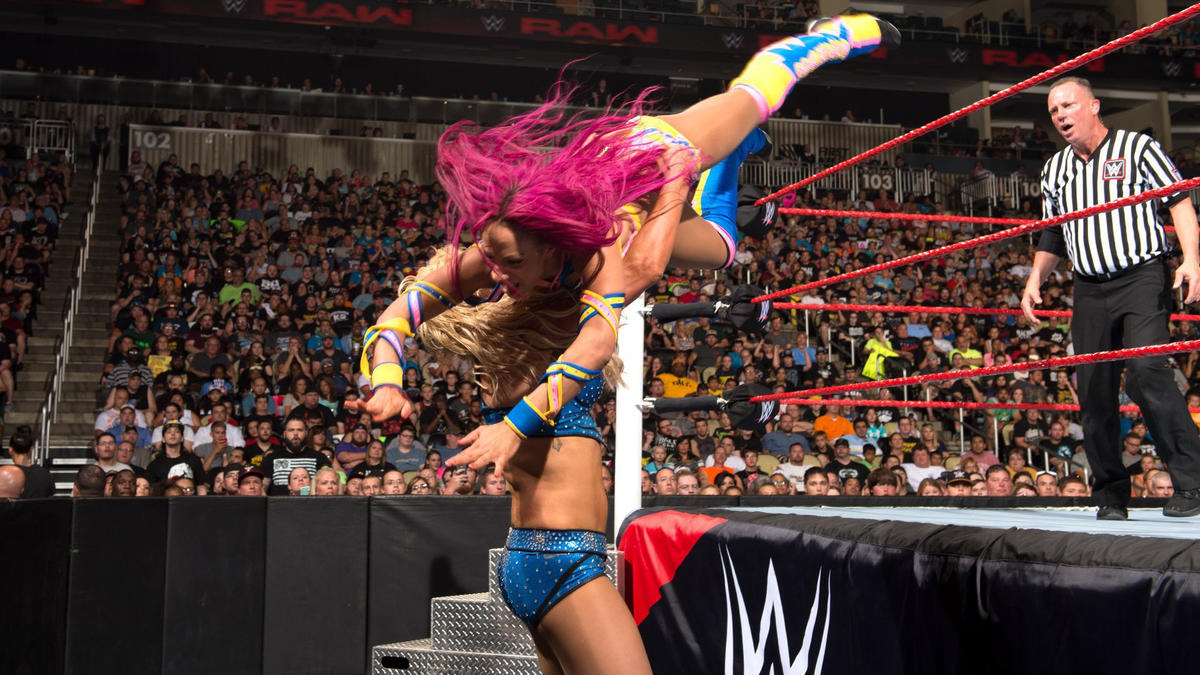In another entry to their classic rivalry, Sasha Banks won the WWE Women's Championship for the first time, defeating The Queen in a red brand thriller.