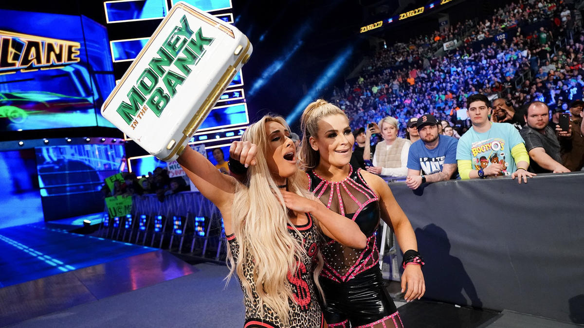 Ms. Money in the Bank & Natalya victoriously exit.