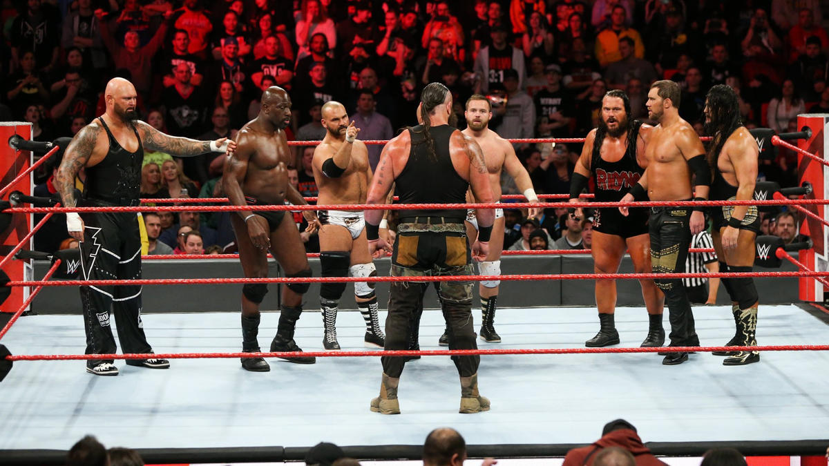 The tag teams decide to work together to take Strowman out of the equation.