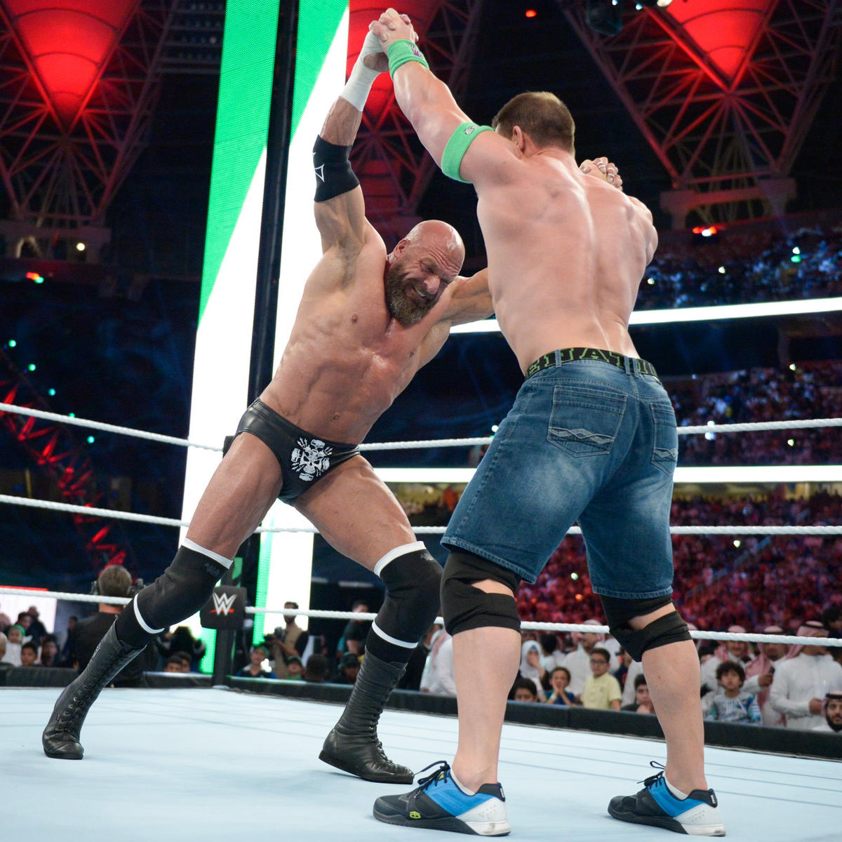 Cena and Triple H engage in a legendary test of strength.
