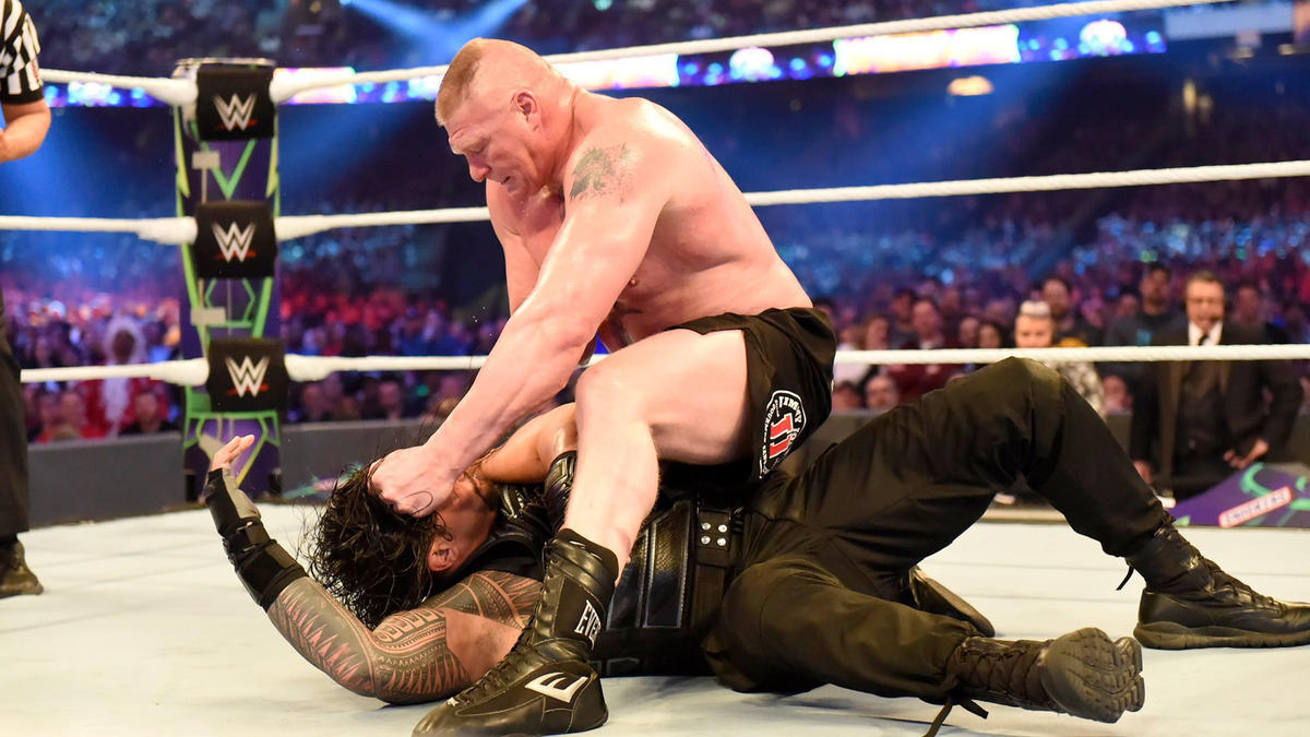 Frustrated that The Big Dog won't stay down, Lesnar unleashes with brutal elbow strikes.