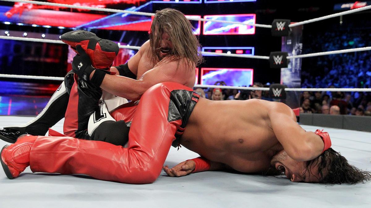 AJ traps Nakamura in the Calf Crusher!