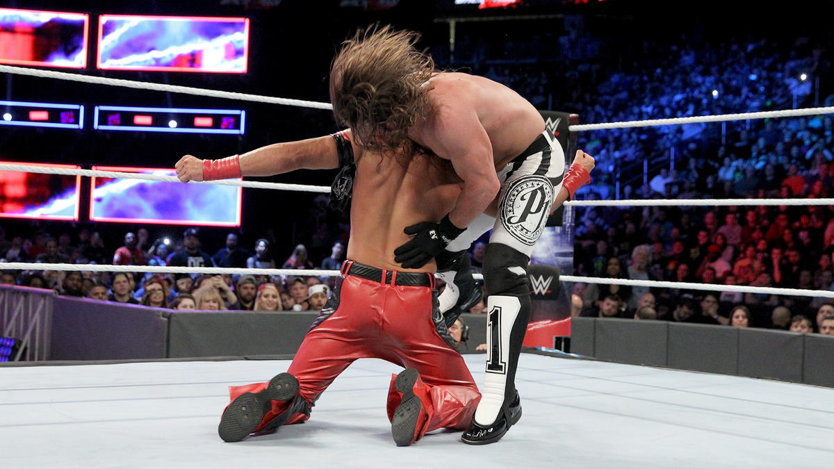 Nakamura takes advantage of the No Disqualification setting with a vicious low blow!