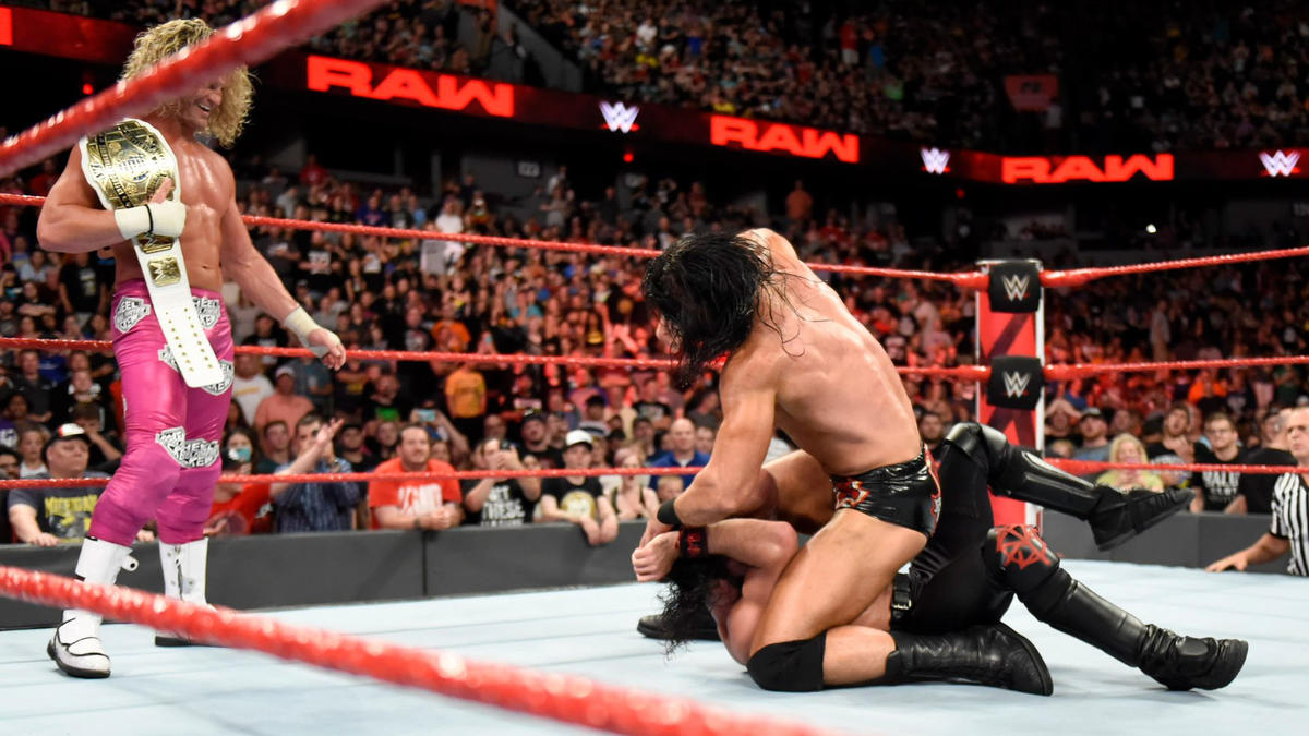 McIntyre attacks Rollins from behind...
