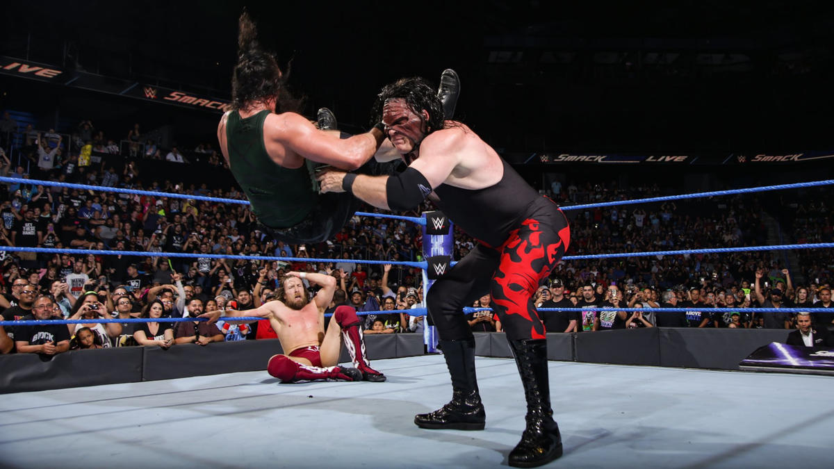 Kane nearly puts Harper through the canvas with a chokeslam!