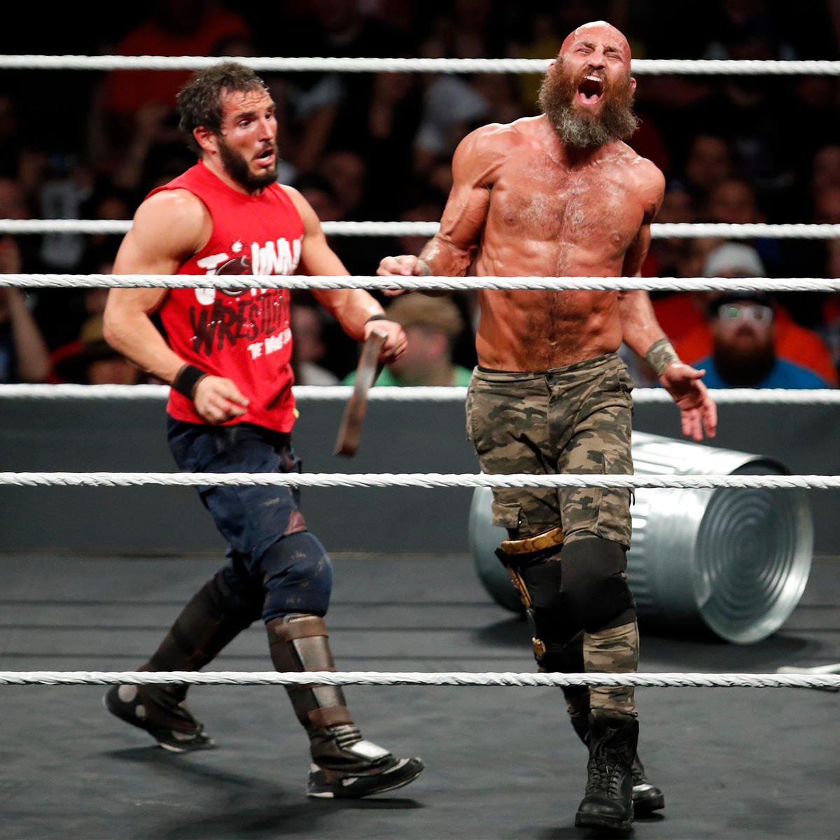 Gargano whips Ciampa with his belt.