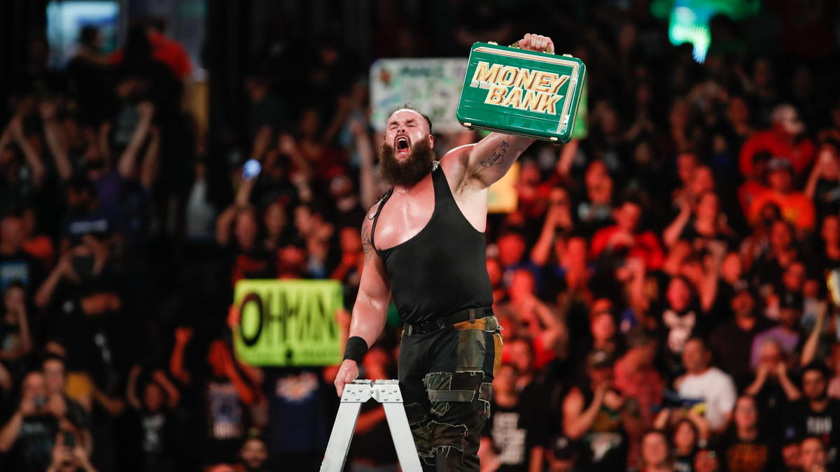 After sending Bálor and Kingston to the canvas below, Strowman unhooks the briefcase to win the match!