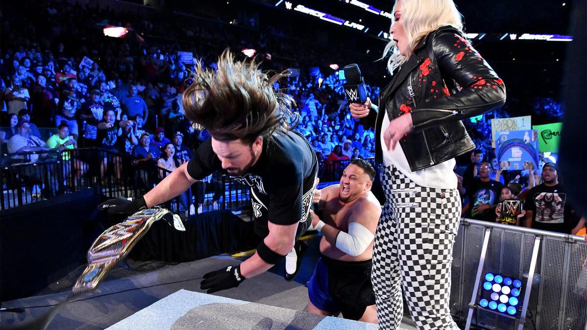 Suddenly, Joe attacks the WWE Champion...