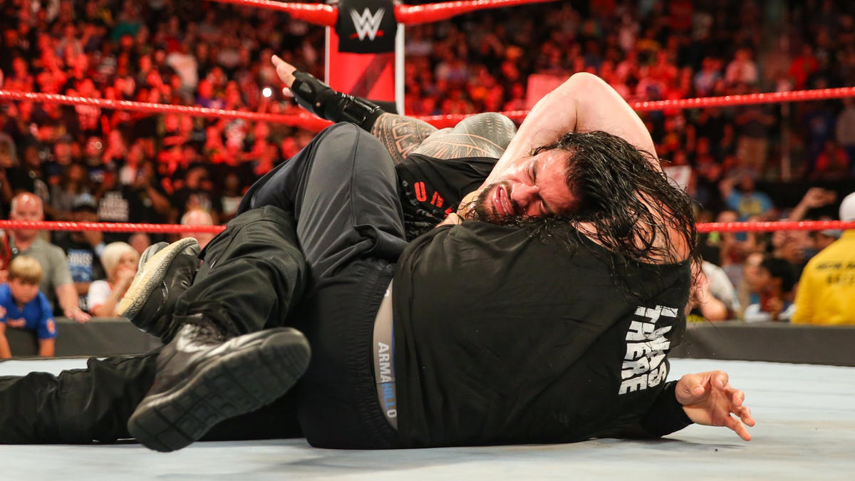 Brock locks Roman in the Guillotine!