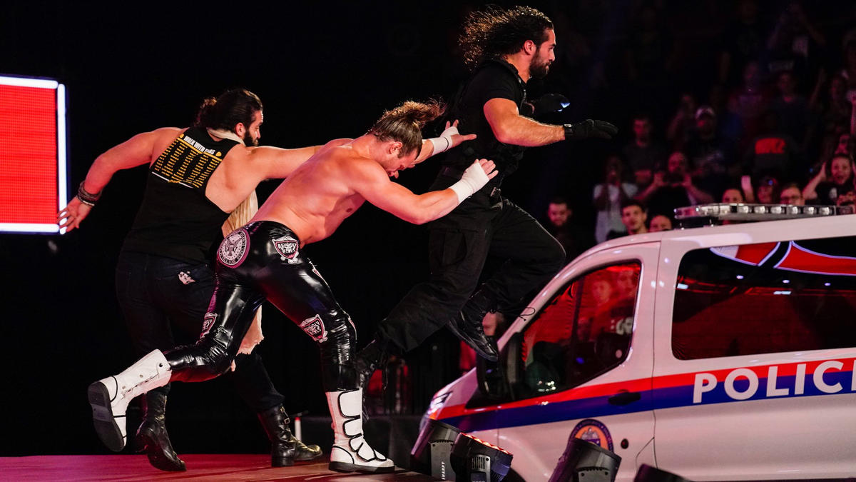 Ziggler and Elias hurl Rollins into the police car!