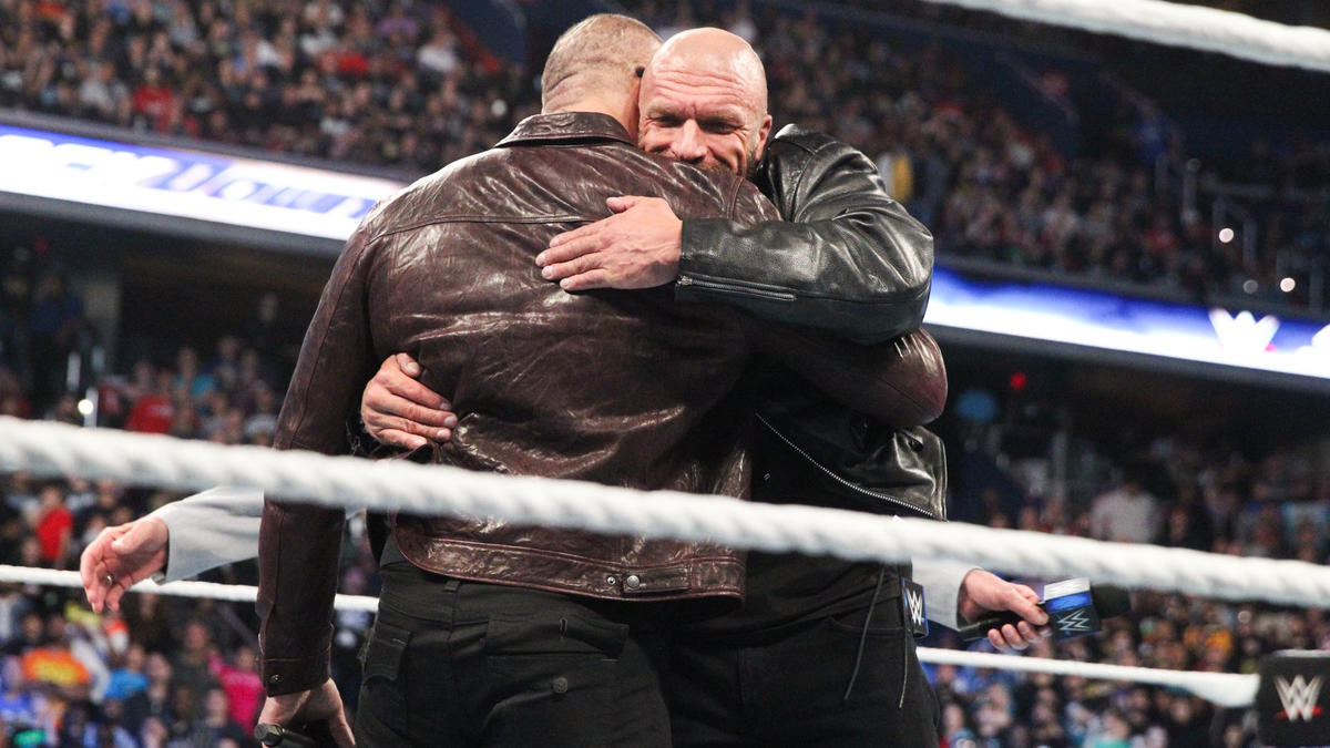 After a few tense moments, Batista and Triple H hug it out.