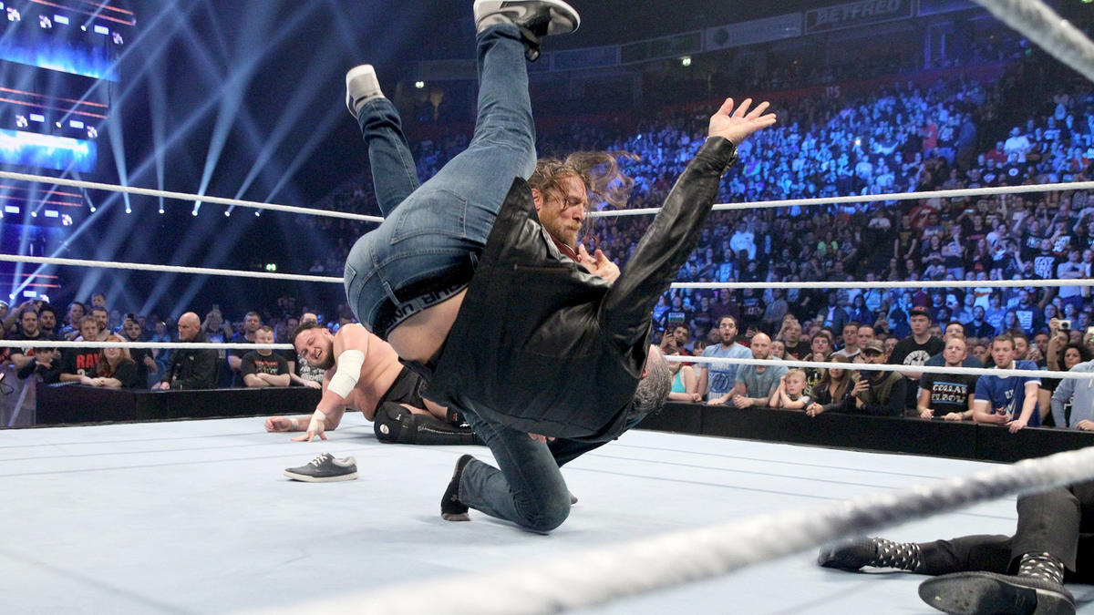 ... but Bryan, seemingly believing Joe was behind him, throws Shane to the canvas!