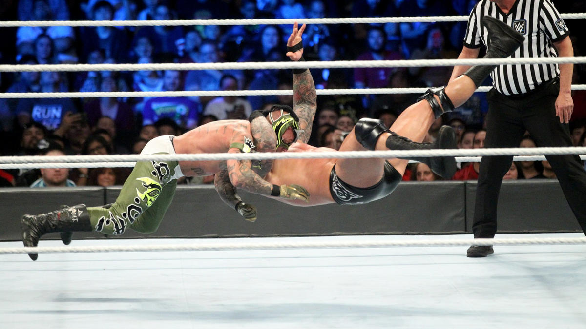 After tossing The Ultimate Underdog back into the ring, The Viper once again levels Mysterio with an RKO for the win!