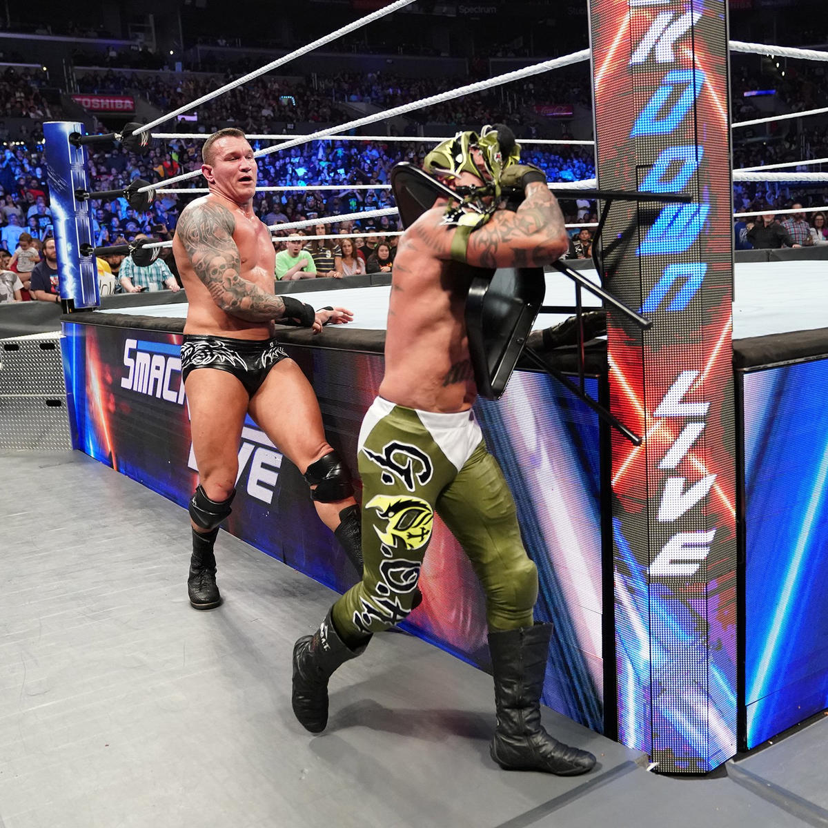 After the bout, Orton places a chair around Mysterio's throat and rams him into the ring post!