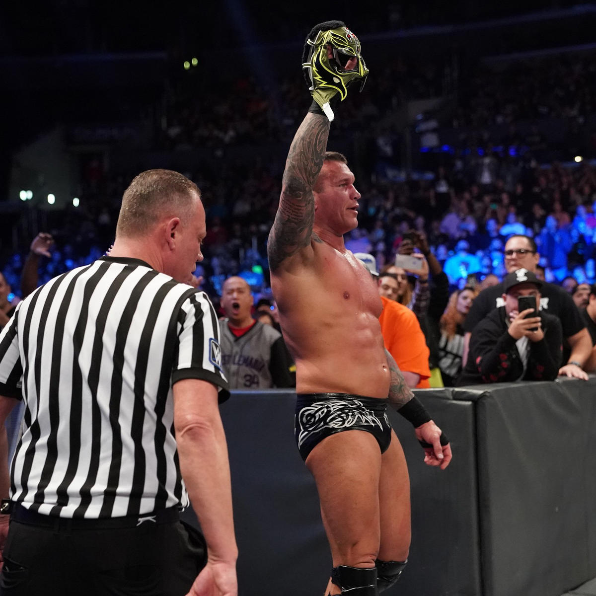 Orton steals Mysterio's mask as SmackDown LIVE concludes.