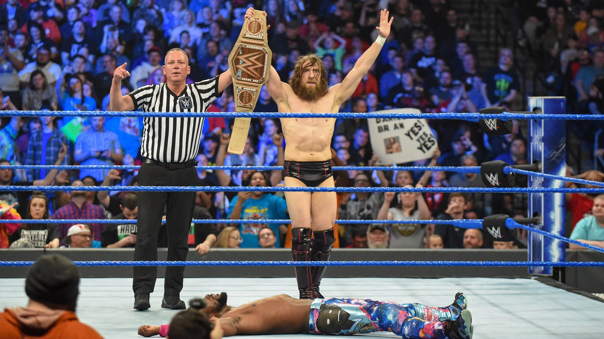 Bryan celebrates his victory, which means Kingston will not challenge him at WrestleMania.