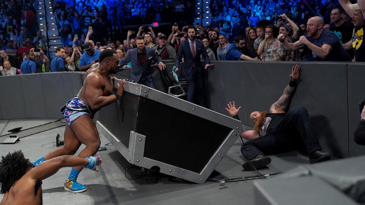 Big E hurls Rowan over the announce table, and New Day win via countout!