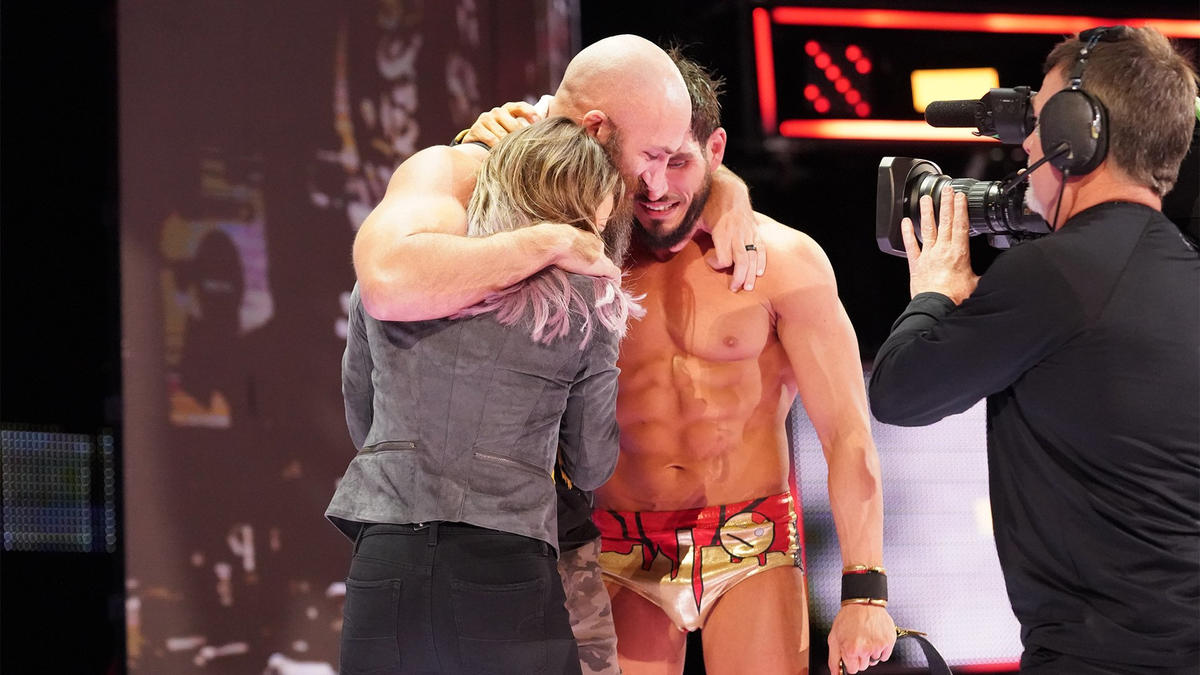 Gargano celebrates with his wife Candice LeRae and former bitter enemy Tommaso Ciampa.