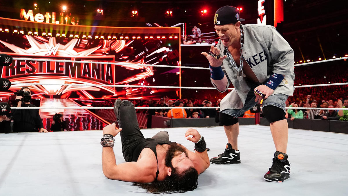 Then Cena drops him with a Five-Knuckle Shuffle and AA.