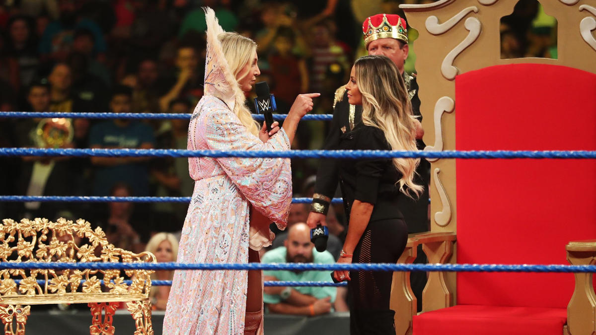 Flair condescendingly congratulates Trish for being a mom.